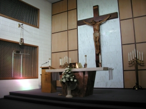 Sanctuary before the renovation. The crucifix is now in our diocesan cathedral