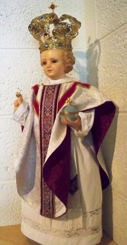 Our Infant statue dressed as a priest